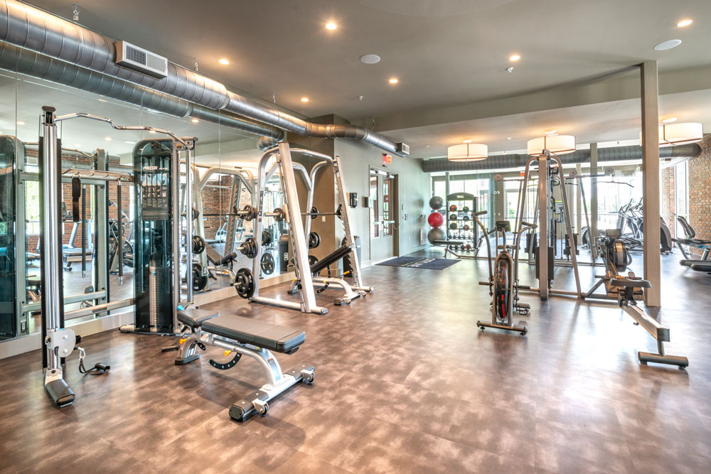 Fitness Center with weight machines, cardio equipment, medicine balls and mirrored walls