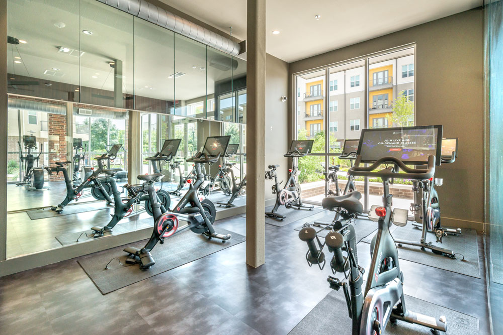 Fitness center with Peloton spin bikes and mirrored wall