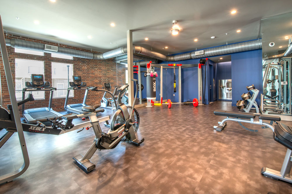 Fitness center with treadmills, spin bikes, ceiling fan and Crossfit station