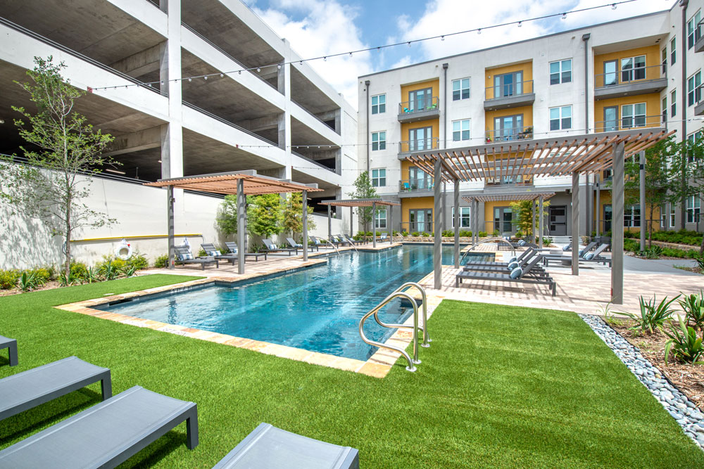 Resort style pool with lounge seating, covered seating, patio lighting and professional landscaping