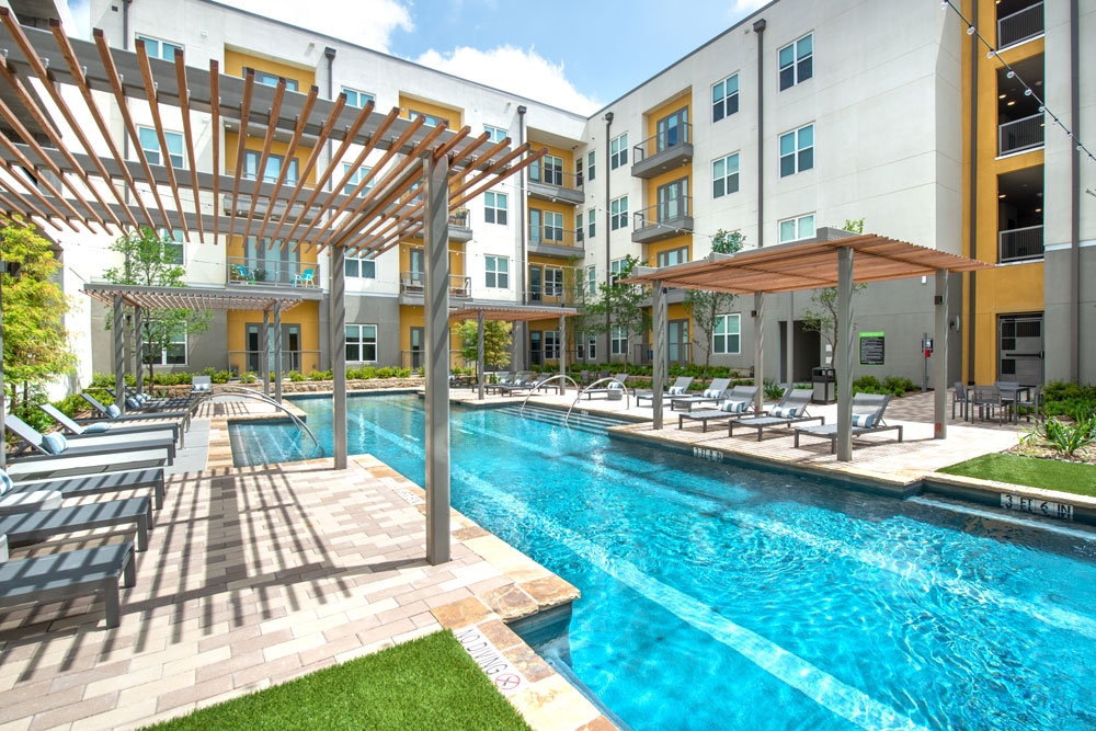 Resort style pool with lap lanes, lounge seating and covered lounge seating