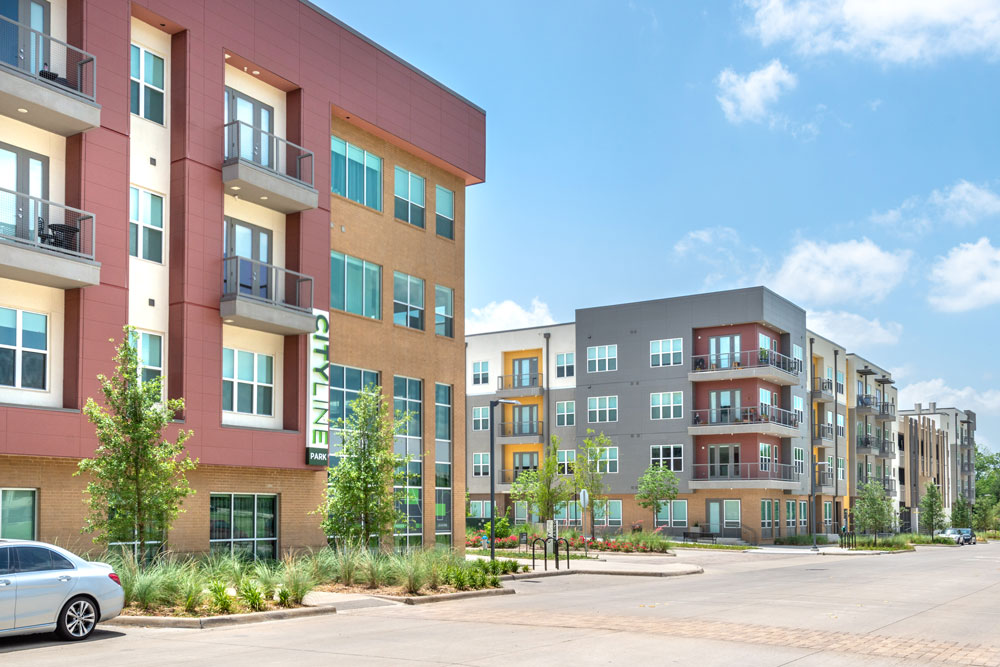 Apartment exterior with professional landscaping, parallel parking and apartment balconies