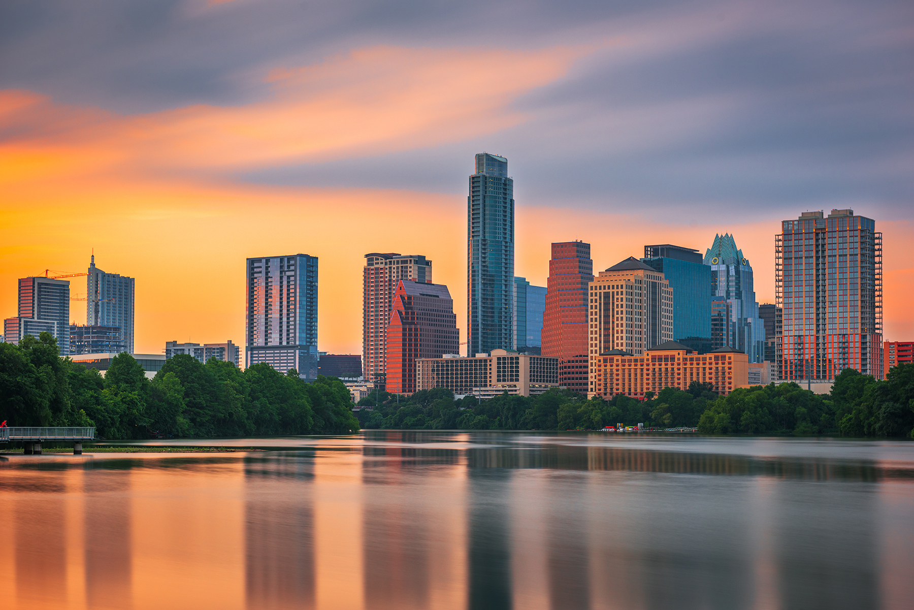 Austin skyline at sunset viewed from Lady Bird Lake and Colorado River