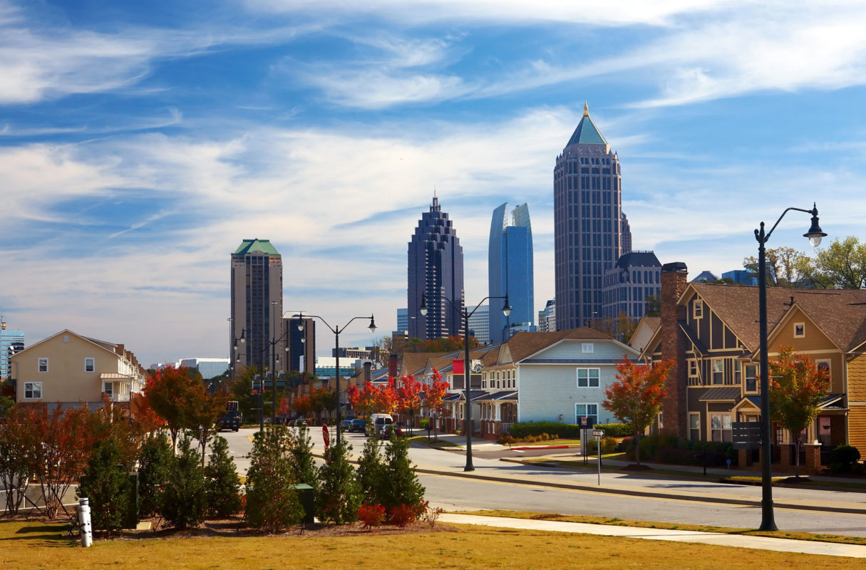street and houses with Atlanta, Georgia skyline