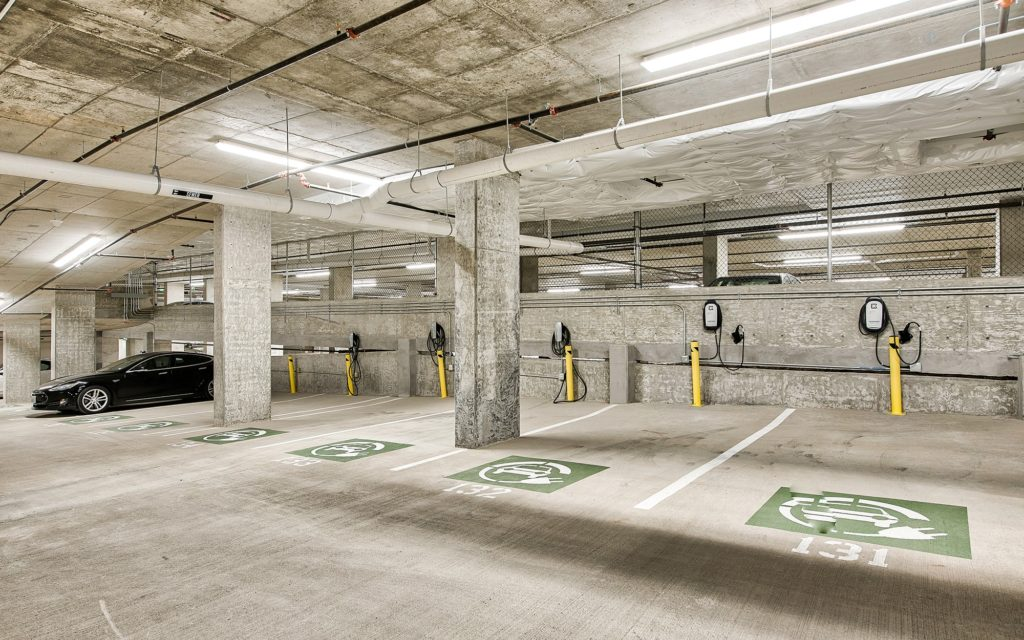 Parking garage with designated electric vehicle parking spots