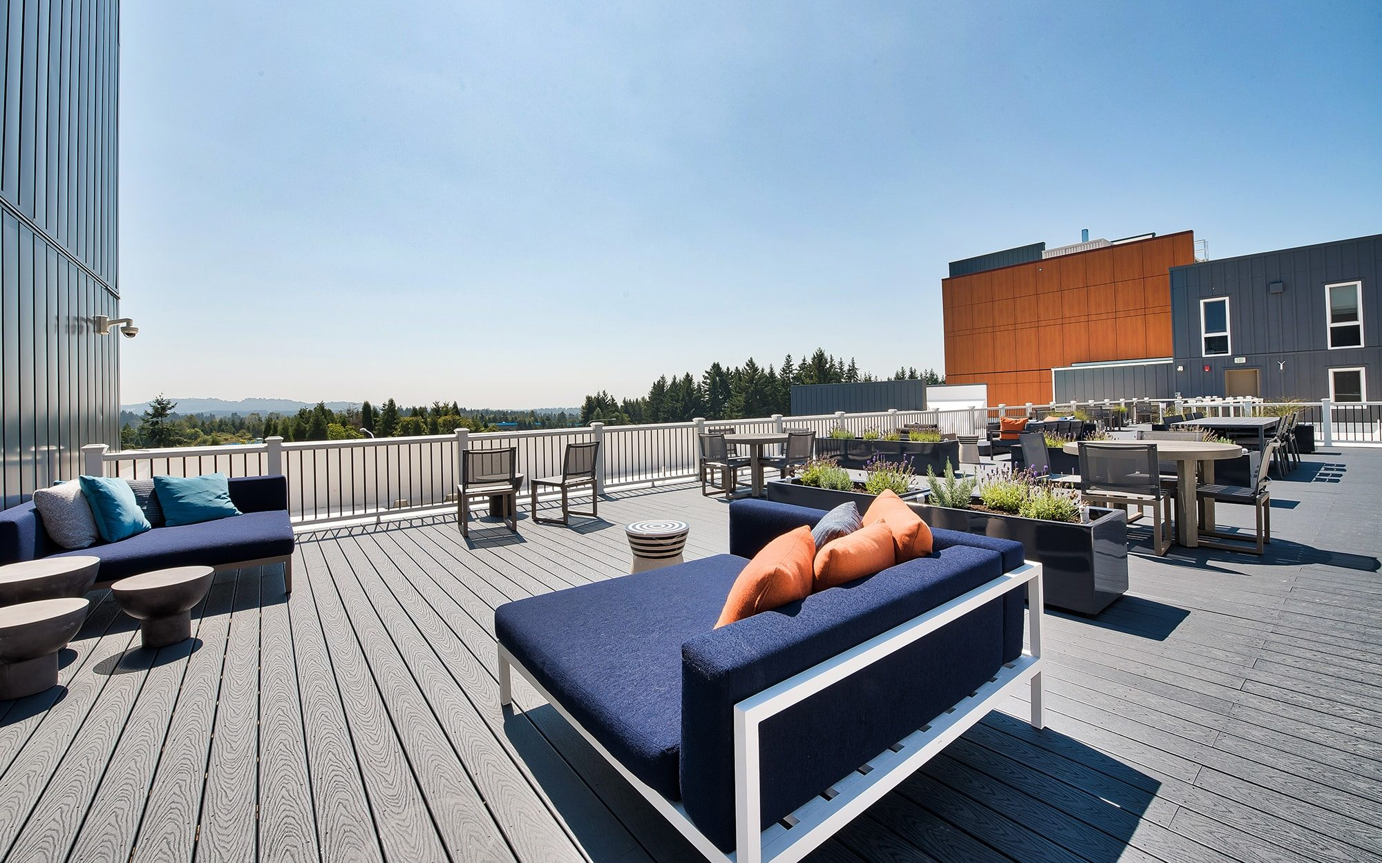 Rooftop amenity space with lounge seating and tables
