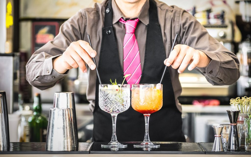 Bartender serving mixed drinks