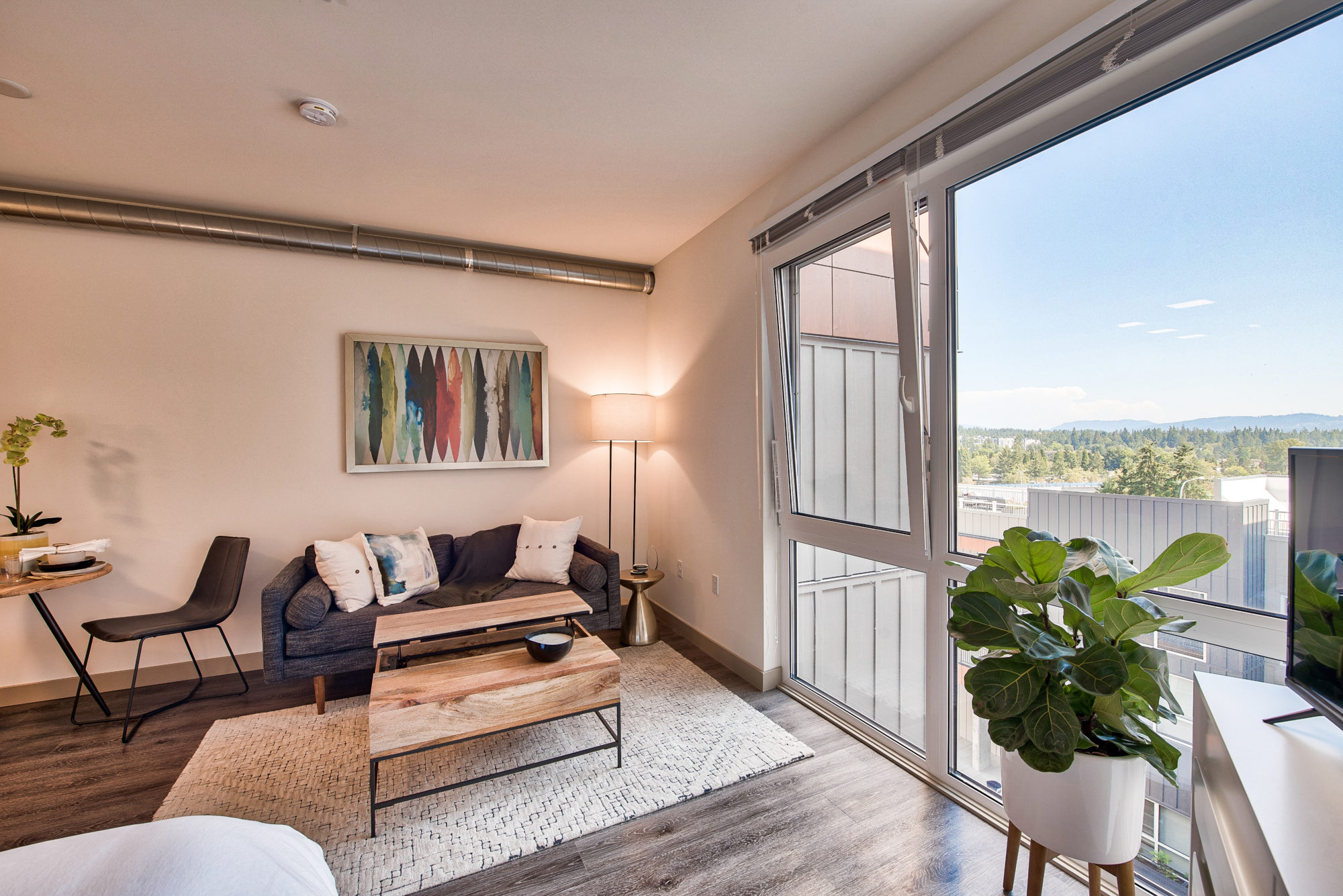 living area with view, hard flooring, windows with views, exposed ventilation.