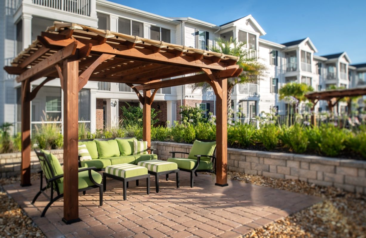 Outdoor trellis or covered patio with lounge seating