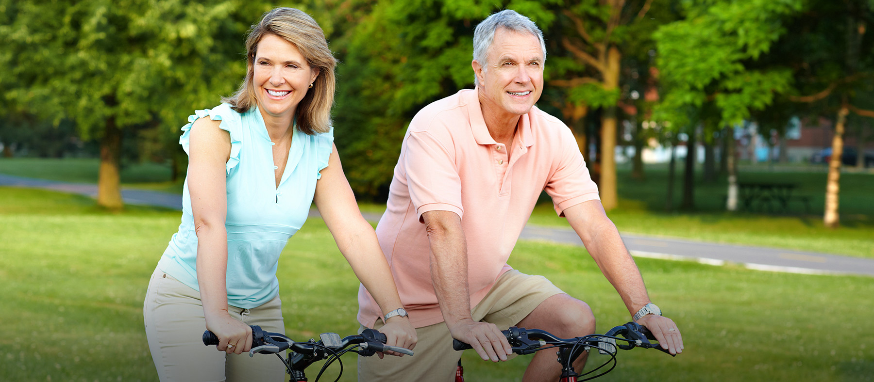 Empty nester senior couple riding bicycles outside