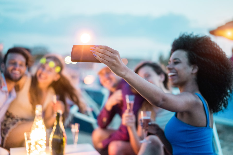 Friends gathered celebrating while taking a selfie