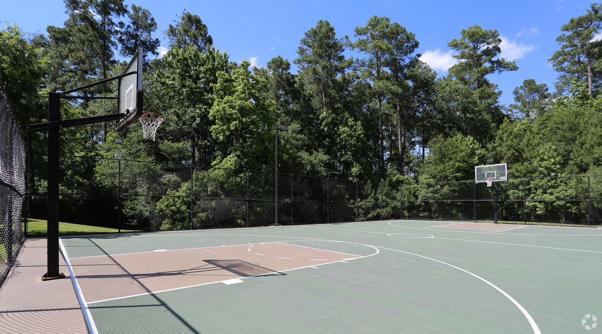 Fenced, outdoor full basketball court