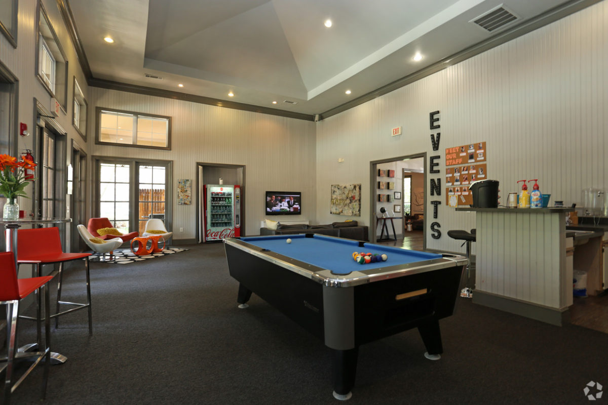 Community room with billiards table, lounge seating, tv, coffee bar, and vending machine