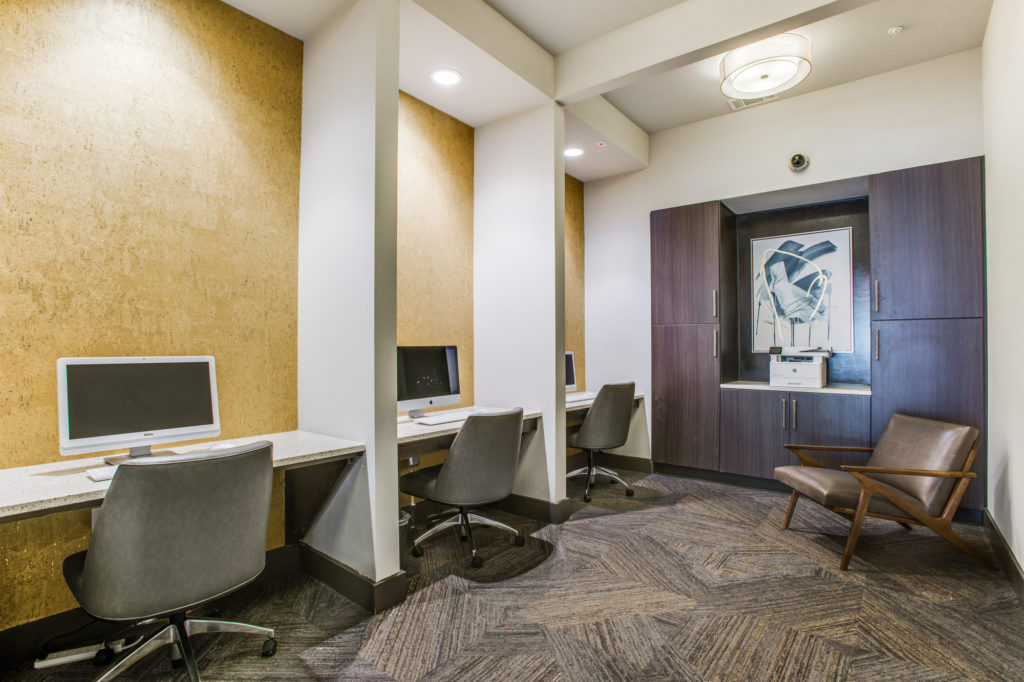 Community business center with three computer workstations and printer