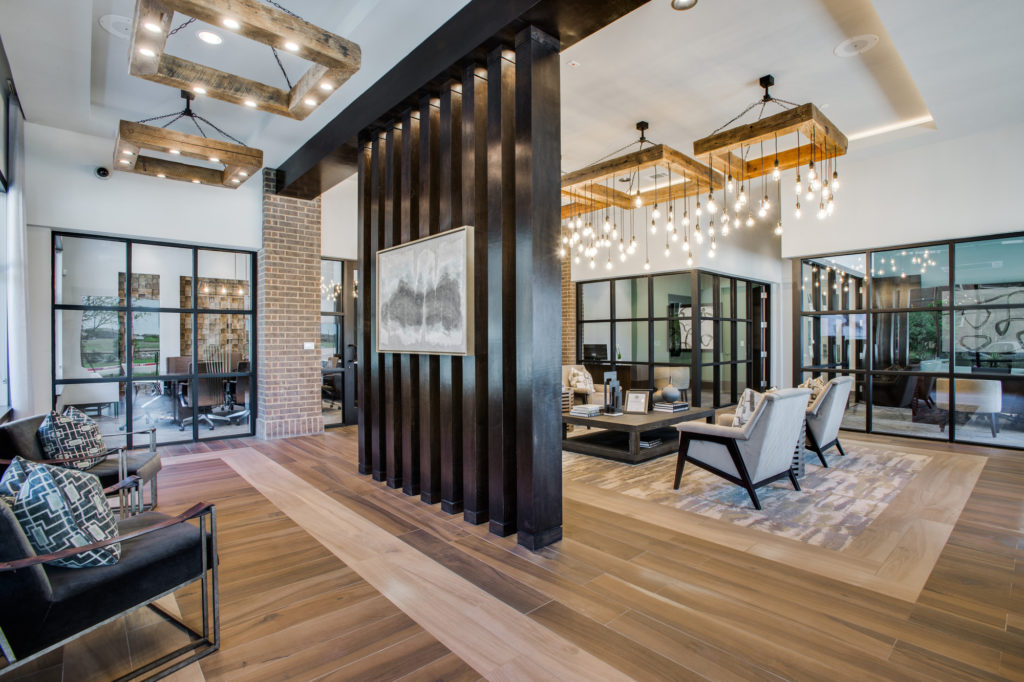 Large decorated community lobby with designer lighting and comfortable seating