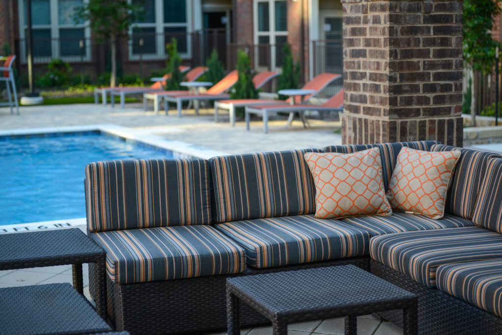 Large sectional couch seating near resort-style pool