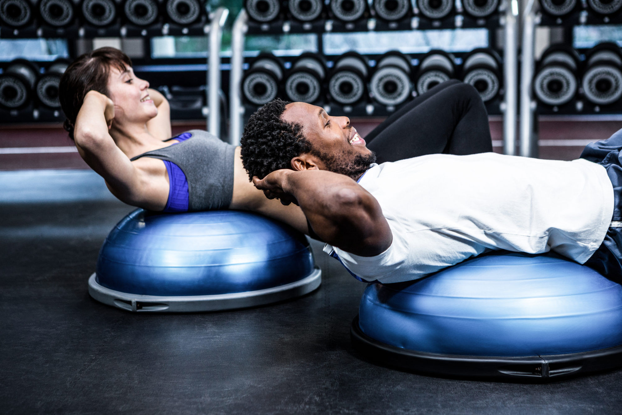Two people exercising in apartment fitness center