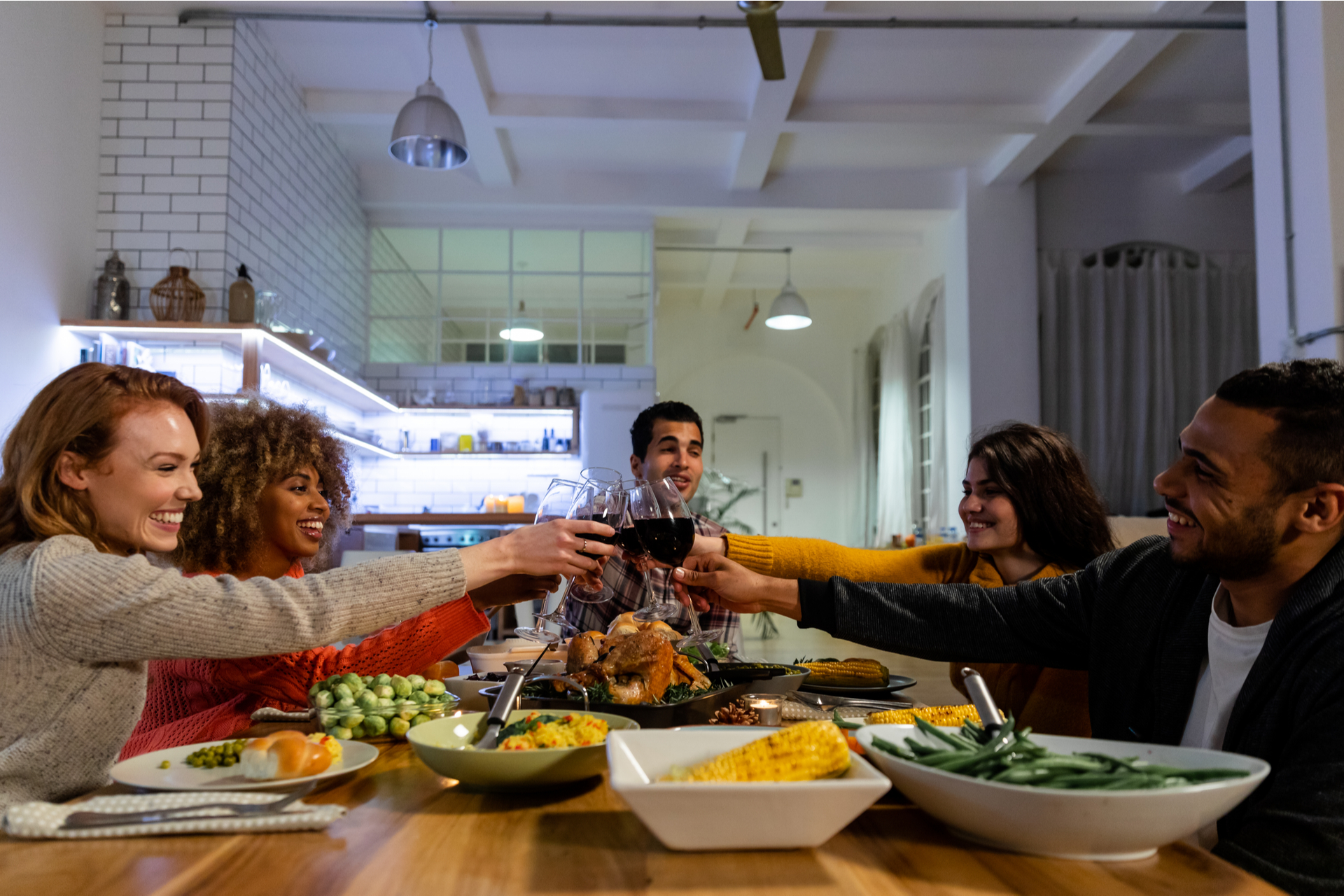 Group Having Thanksgiving dinner at apartment