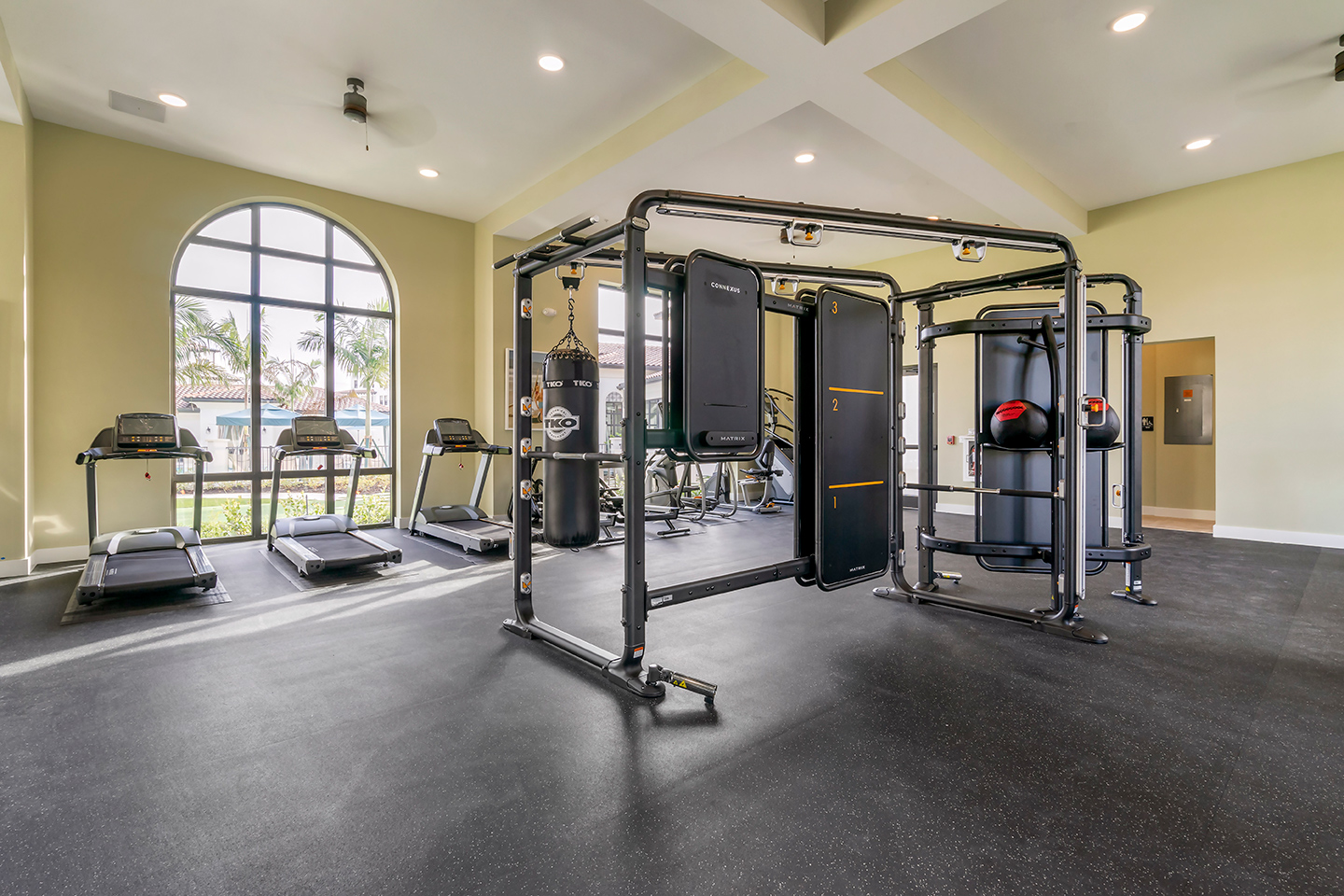 Community fitness center with cardio machines and strength training equipment