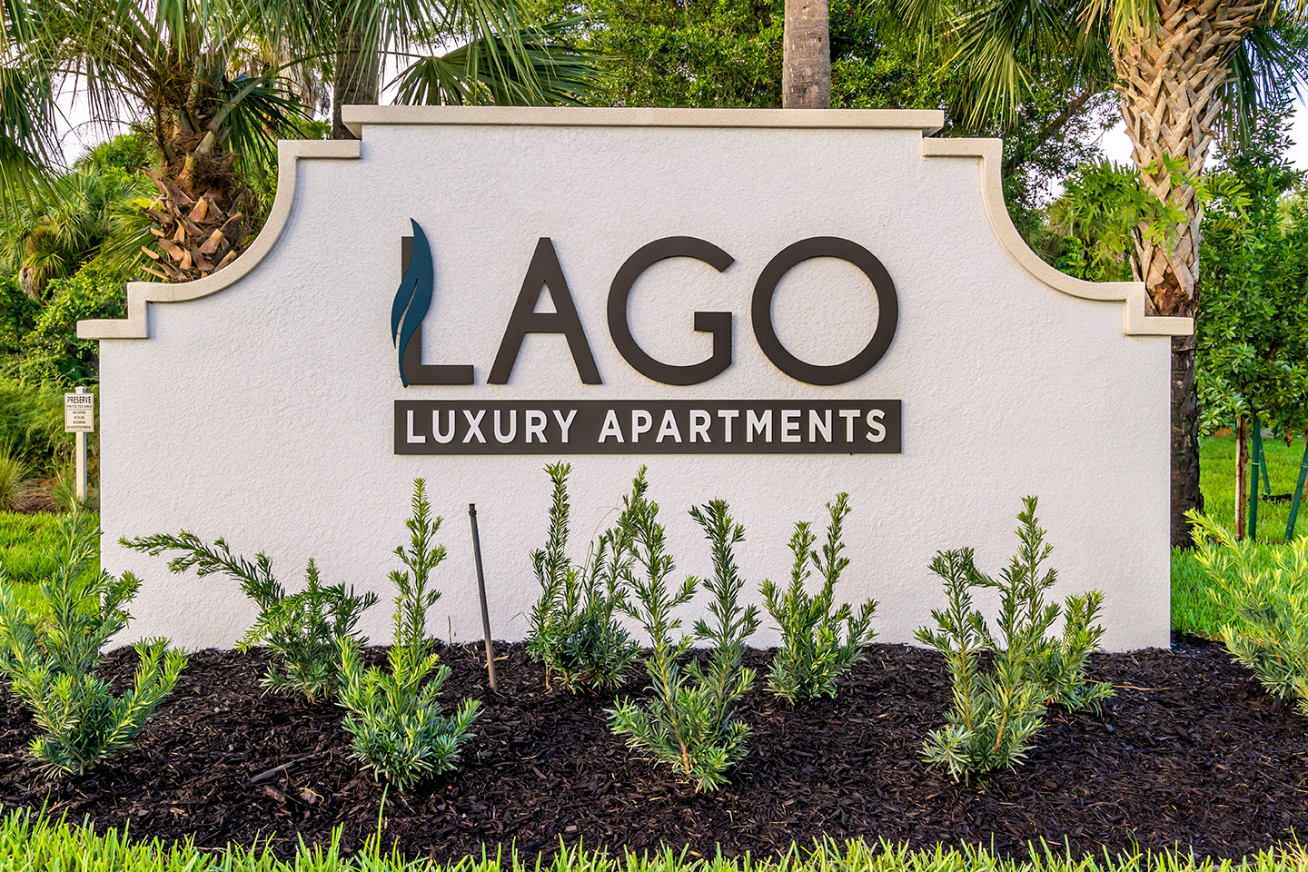 Monument sign for Lago luxury apartment community in Naples