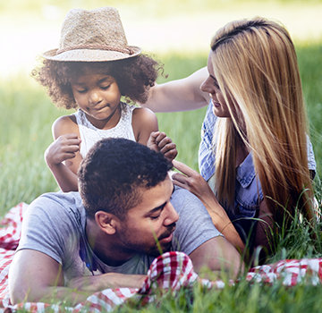 Young family enjoying a picnic in a park.
