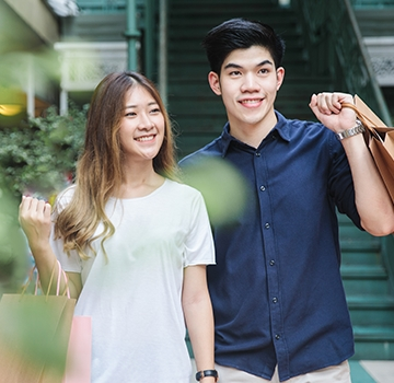 Young couple out shopping in urban mall.