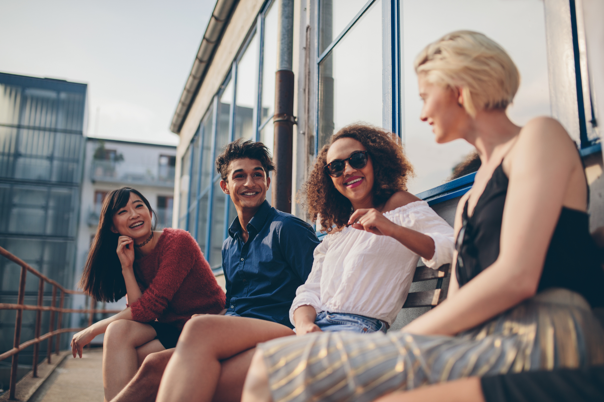 Diverse multiethnic group of friends on balcony fun
