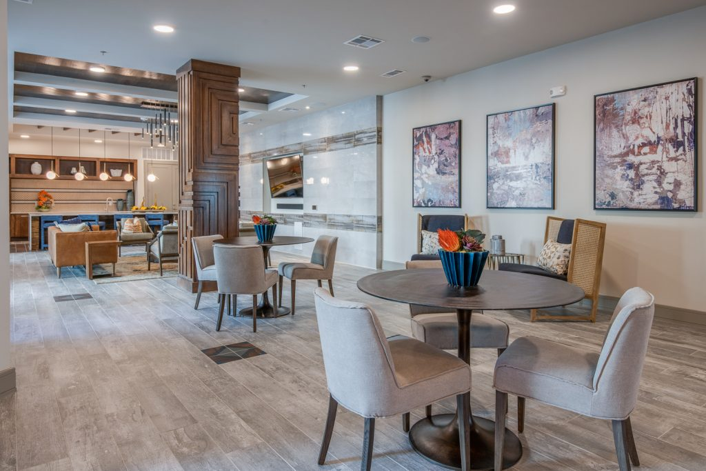 clubhouse area with seating and wall art decor