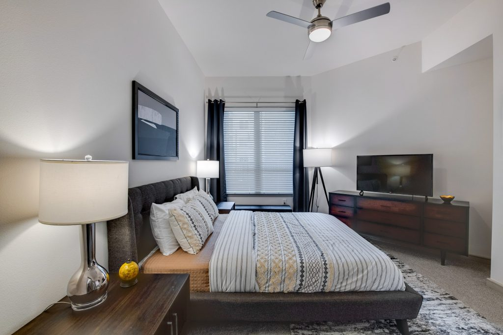 bedroom with ceiling fan and decor