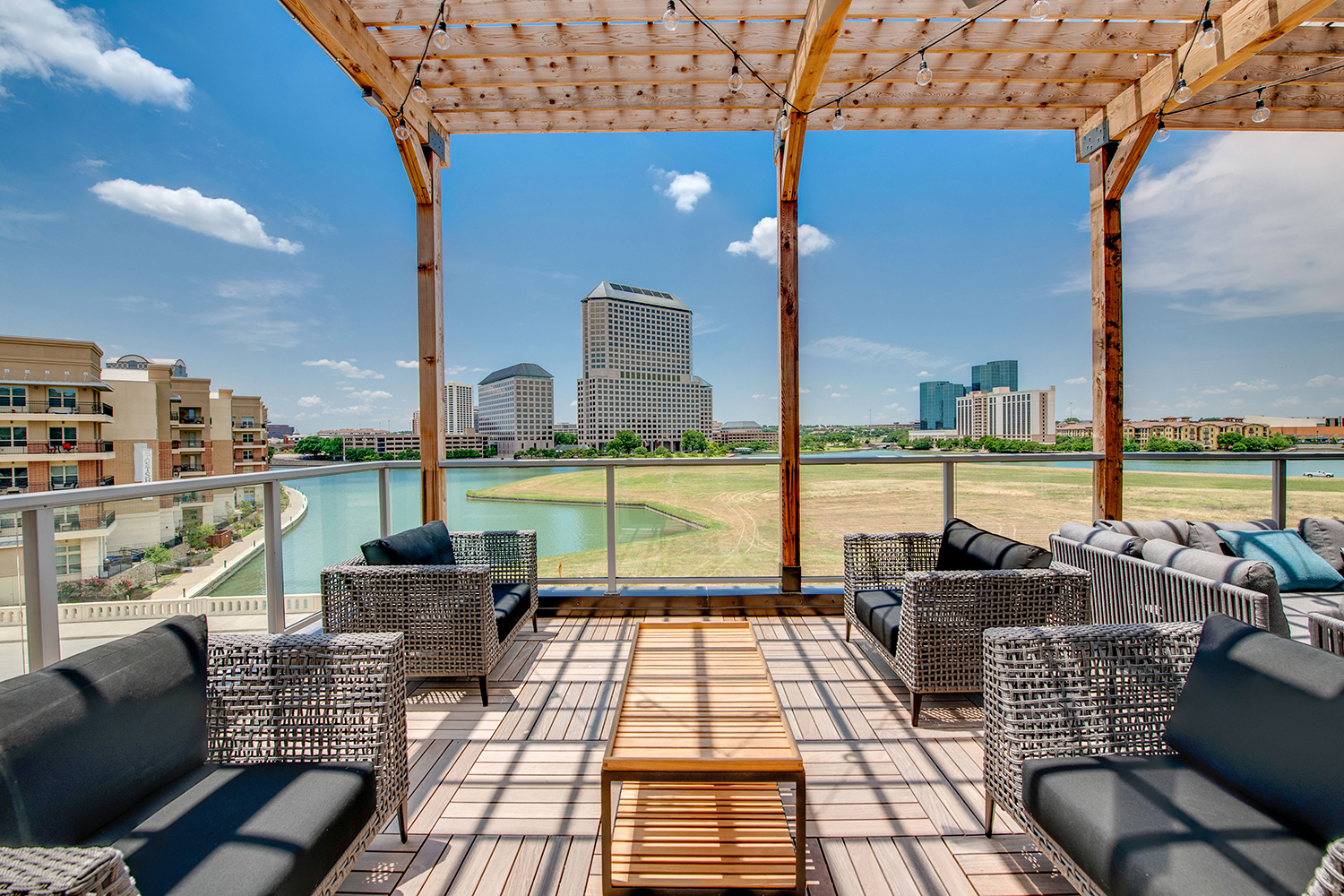 outdoor patio lounge with seating with view of small lake