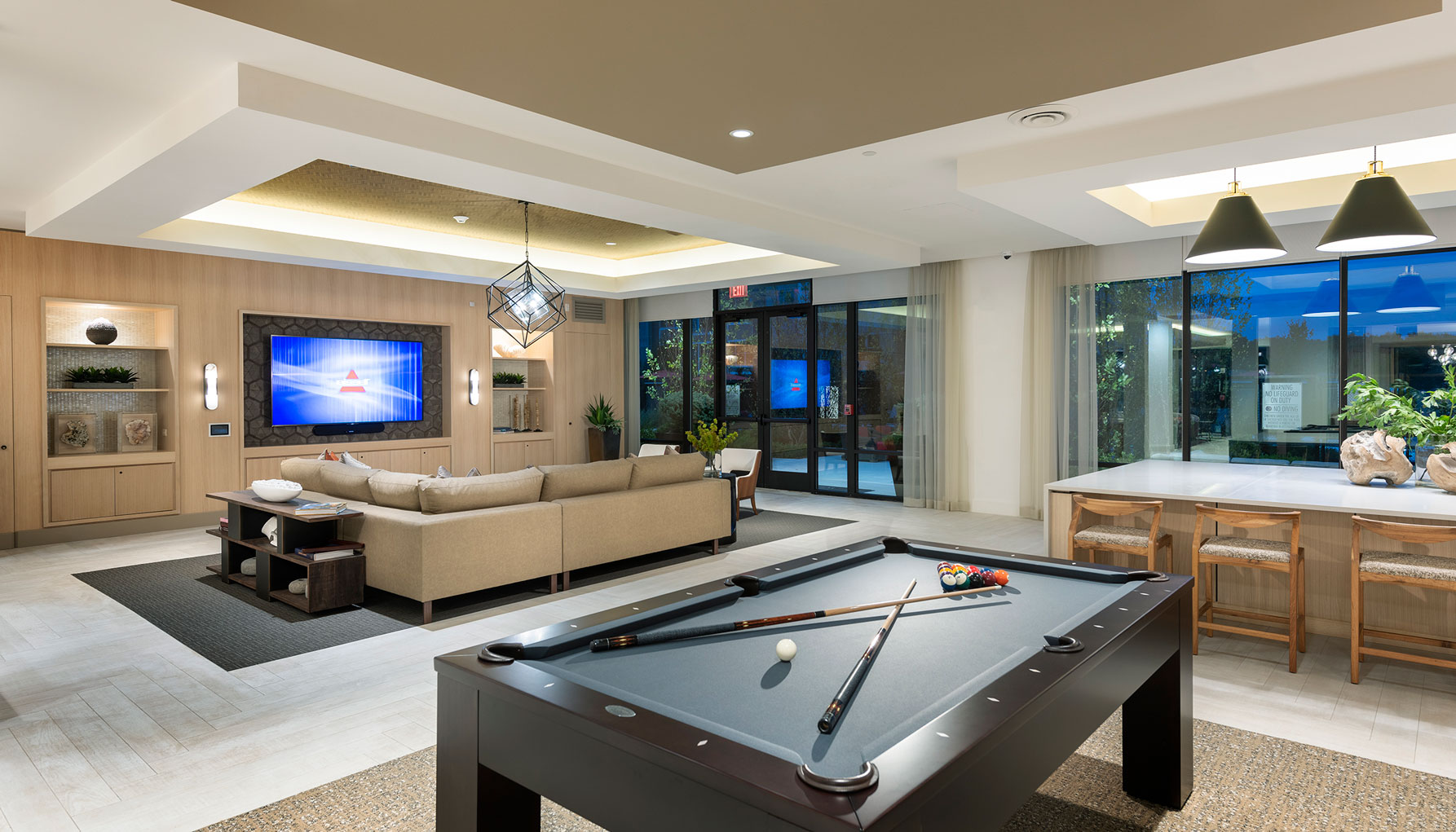 Clubhouse with variety of seating, flat screen TV and pool table