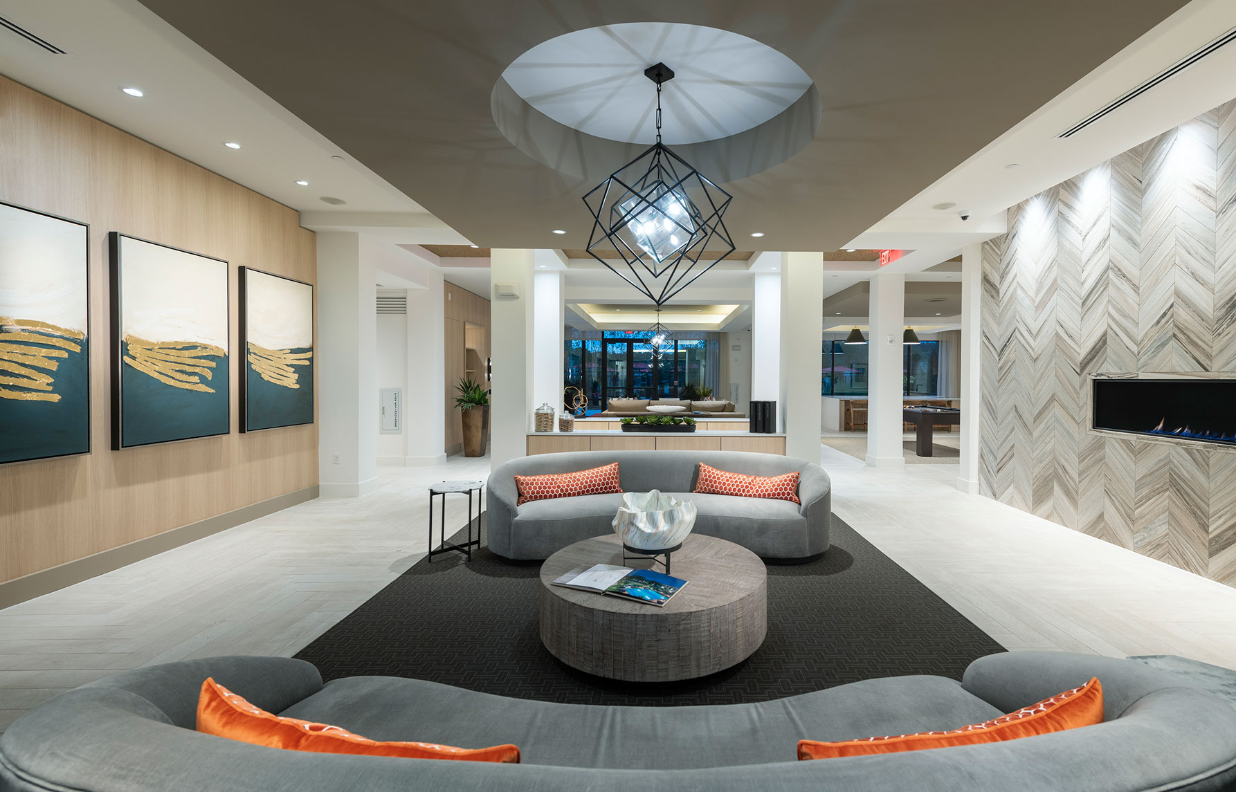 Clubhouse with designer modern furniture, designer lighting, fireplace and welcome desk