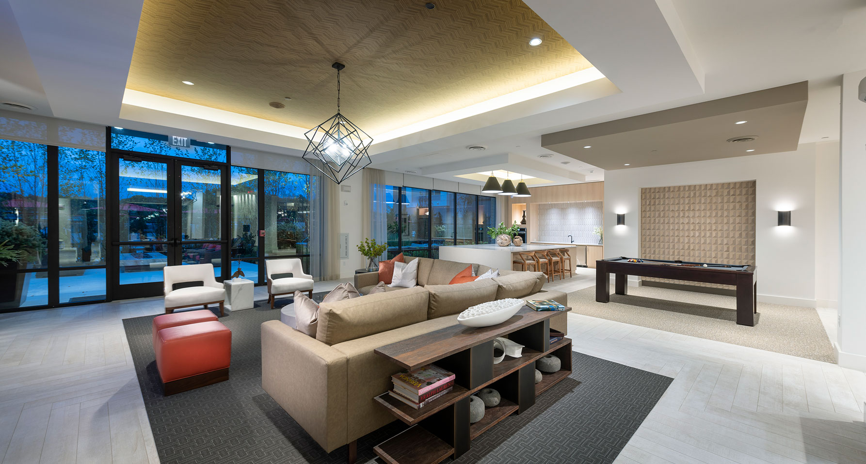 Clubhouse with variety of seating, pool table, kitchen and designer lighting
