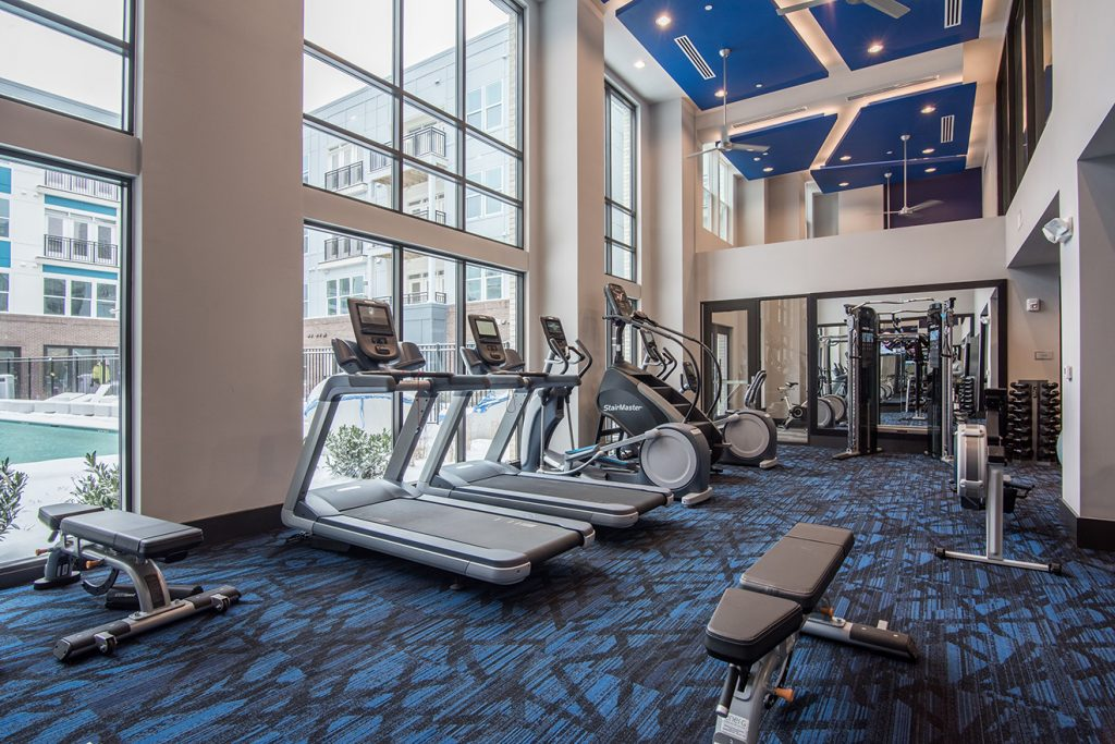 Fitness center with cardio machines, ellipticals, and strength training equipment