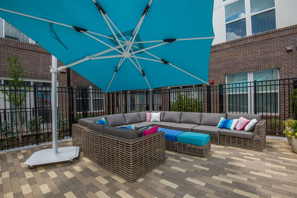 Outdoor lounge seating with sectional sofa and large umbrella