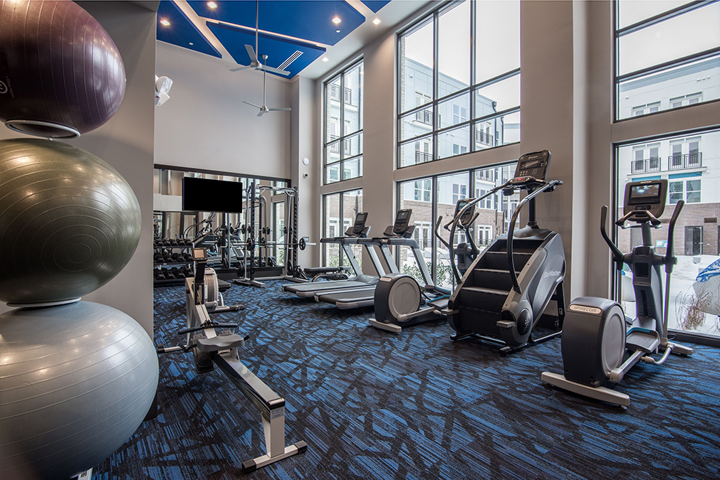 Fitness center with treadmills, stairmaster, and elliptical machines