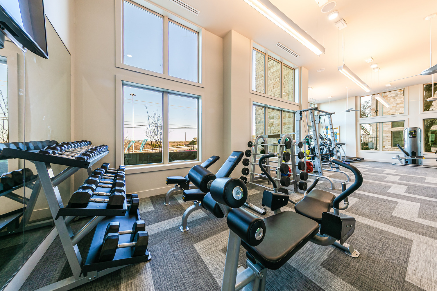 Strength training equipment and free weights in community fitness center