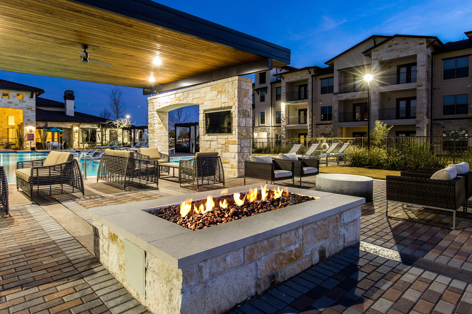 Fire pit and outdoor seating area near pool deck