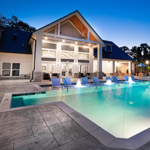 night shot of pool and clubhouse