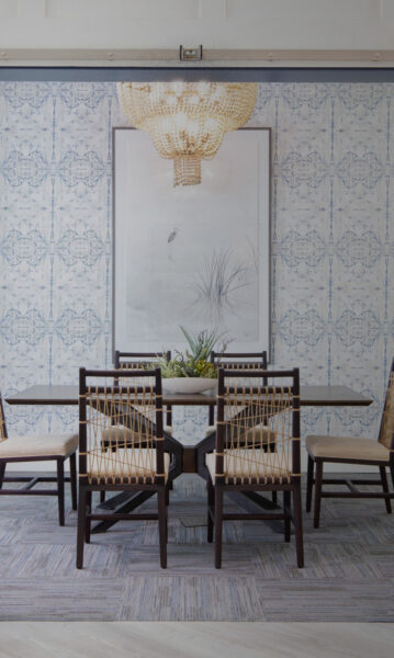 dining table with large art on all and chandelier