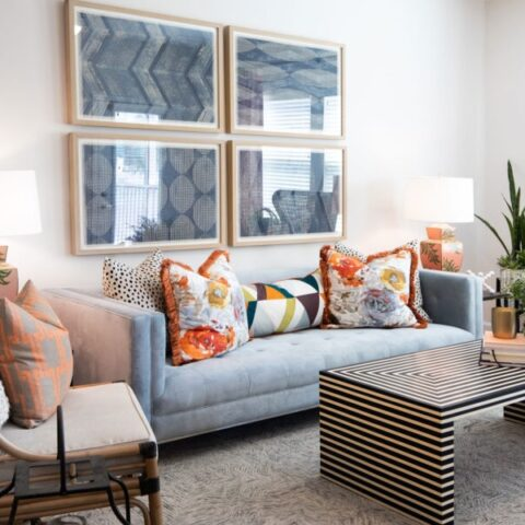 living room with couch, wall art, and decor