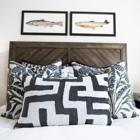 bed with decorative pillows and wall art